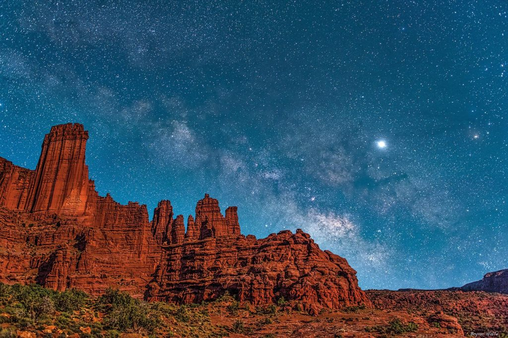 Fisher Towers lit by a crescent moon and the Milky Way